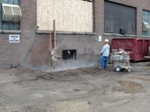 Commercial Garage Renovation cuts Through Concrete Wall and Floor